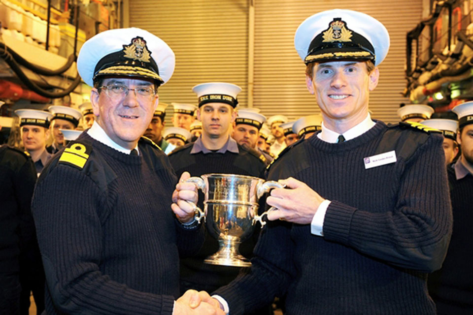 Rear Admiral Peter Hudson presenting the 2011 Frigate Efficiency Trophy to HMS Iron Duke's Commanding Officer, Commander Nick Cooke-Priest