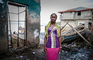 Celina Kamanda stands near the water's edge in Magazine Wharf - one of Freetown's largest slums, where families were hit hard by the Ebola outbreak. Picture: Simon Davis/DFID