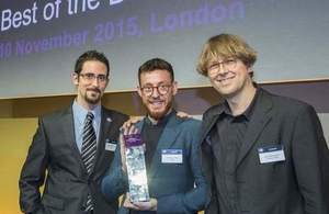 Miguel Martinez-Alvarez (left) and David Benigson of Signal Media (holding award) with Professor Udo Kruschwitz, of Essex University (right)