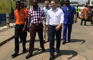 Minister Shapps visits PEG Ghana customers in the Abossey Okai area of Accra. Picture: Jessica Seldon/DFID.