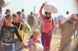 Syrian Kurdish refugees cross into Turkey, September 2014. According to UN figures, there are more than 2 million Syrian refugees registered in Turkey. Picture: EC/ECHO