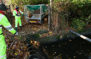 Field service operatives clearing blockages to reduce flood risk