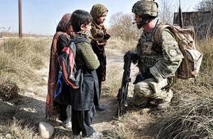 Afghan children alert Corporal Martin