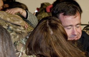 RAF airmen and women of 12(B) Squadron are greeted by their loved ones at RAF Lossiemouth following a four-month deployment to Afghanistan
