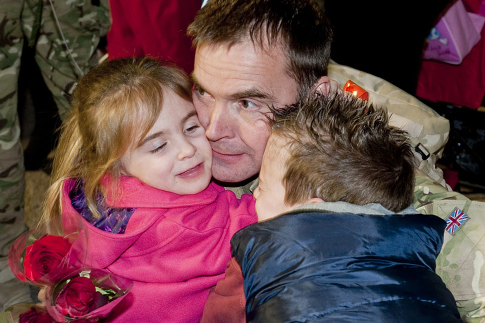 An airman of 12(B) Squadron is greeted by his children