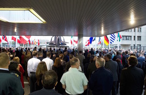 NATO staff observe a minute of silence