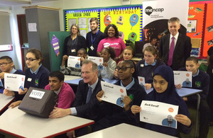 John Penrose with Mencap Ambassador Vijay Patel and pupils at Little Heath School.