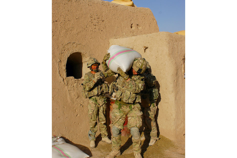 Soldiers from 1st Battalion The Princess of Wales's Royal Regiment seize cannabis seeds from a compound