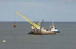 Strekker, the crane barge, which is removing debris from the dredge site. Copyright Boskalis Westminister Ltd. All rights reserved.