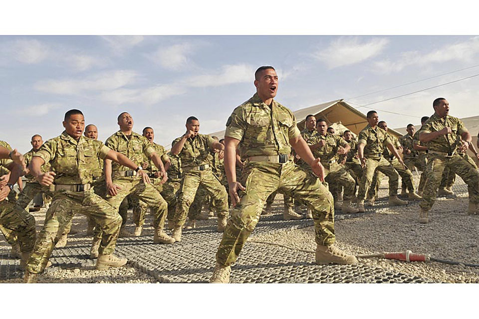 Tongan troops perform their traditional war dance, the Sipi Tau, to mark the start of their duties at Camp Bastion