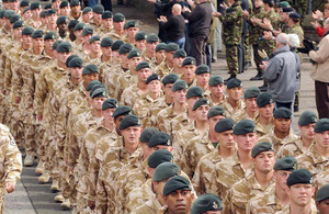 Members of the 3 RIFLES Battle Group march
