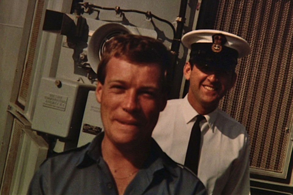 Able Seaman Neil Wilkinson (in front of shot) on board Intrepid in 1982, aged 22