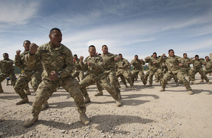 Tongan troops from the 3rd Contingent of the Tonga Defence Services perform the Sipi Tau war challenge for the Tongan Prime Minister to welcome him to Camp Bastion