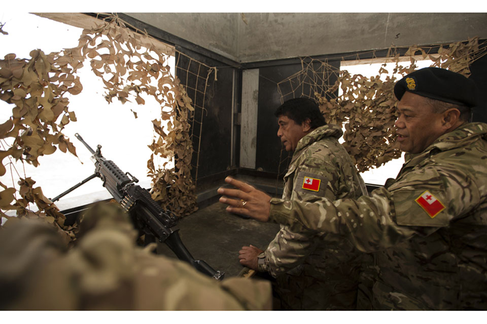 The Tongan Prime Minister, His Excellency Lord Tu'ivakano, visits one of Camp Bastion's perimeter towers to learn about the role of the Tonga Defence Services in providing security for the base
