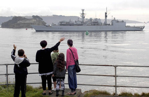 HMS Cumberland passes Drake's Island in Plymouth Sound as she leaves for the Middle East