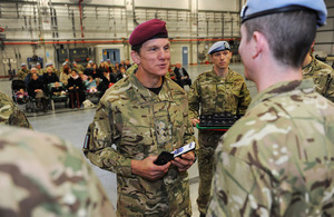 Colonel Jacko Jackson presents soldiers with campaign medals