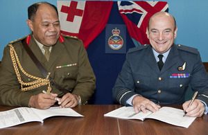 Brigadier General Tau'aika 'Uta'atu, Commander of the Tonga Defence Services, and Air Marshal Sir Stuart Peach, Chief of Joint Operations, sign the memorandum of understanding committing Tongan troops to ISAF's campaign in Afghanistan
