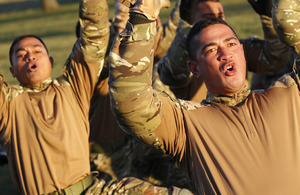 Tongan troops perform their fearsome war dance, the 'Sipi Tau', at RAF Honington
