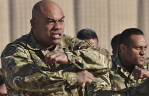 A contingent from the Tonga Defence Services issue a traditional challenge, called a Sipi Tau, to their replacements during a ceremonial handover in Camp Bastion, Afghanistan