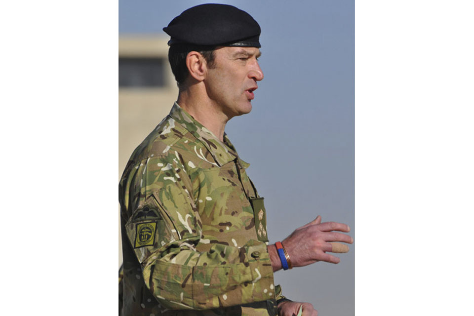 Brigadier 'Mitch' Mitchell addresses the Tongan contingent during the ceremonial handover in Camp Bastion, Afghanistan