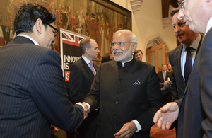 Ajay Gupta is introduced to India's Prime Minister by Prime Minister David Cameron and Lord Maude, Minister for Trade and Investment