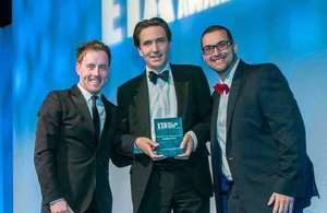 Crowd Connected founder James Cobb holding one of his Event Technology Awards 2015, flanked by presenter Andrew Ryan and sponsor Julius Solaris