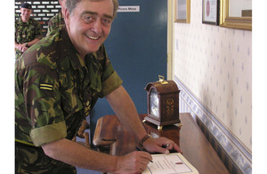 Major General The Duke of Westminster signs the visitors' book at Fenham Barracks, headquarters of 201 Field Hospital