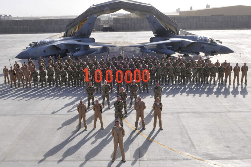 617 Squadron ground and aircrew at Kandahar Airfield, Afghanistan, commemorate one million hours flown by the Tornado GR Force