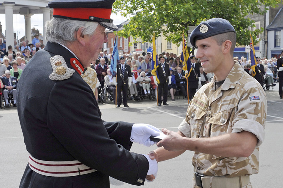 Richard Jewson, the Lord-Lieutenant of Norfolk, presents a member of II (Army Cooperation) Squadron with his Operational Service Medal