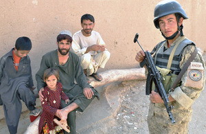 An Afghan National Civil Order Police officer with villagers