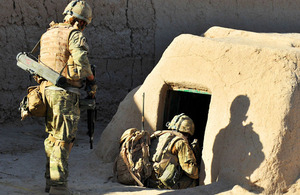 Royal Marines investigate a compound