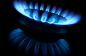 A gas ring with blue flames.