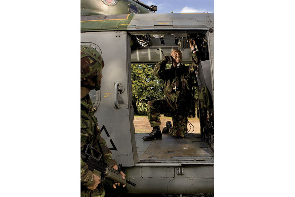 A Craftsman works inside a Lynx helicopter during a fault-finding exercise