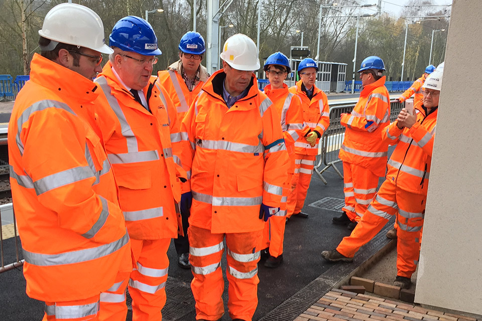 Transport Secretary Patrick McLoughlin views progress at Kirkstall Forge train station.