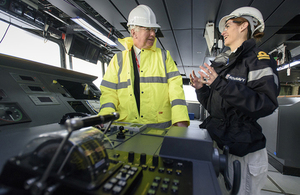 Deputy Navigator Lt Rachel Campbell with the Defence Secretary at the HMS Queen Elizabeth Bridge. Picture: Aircraft Carrier Alliance, John Linton 2015.