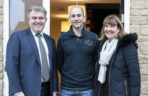 Brandon Lewis with home owner Chris and Heather Bowman from Sovereign Housing Association