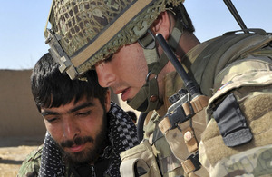 A British soldier from 2nd Battalion The Parachute Regiment and a member of the Afghan National Army plot a patrol route in northern Nad 'Ali (stock image)