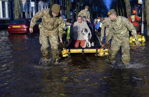 Soldiers from 2nd Battalion The Duke of Lancaster's Regiment help evacuate residents. Crown Copyright.