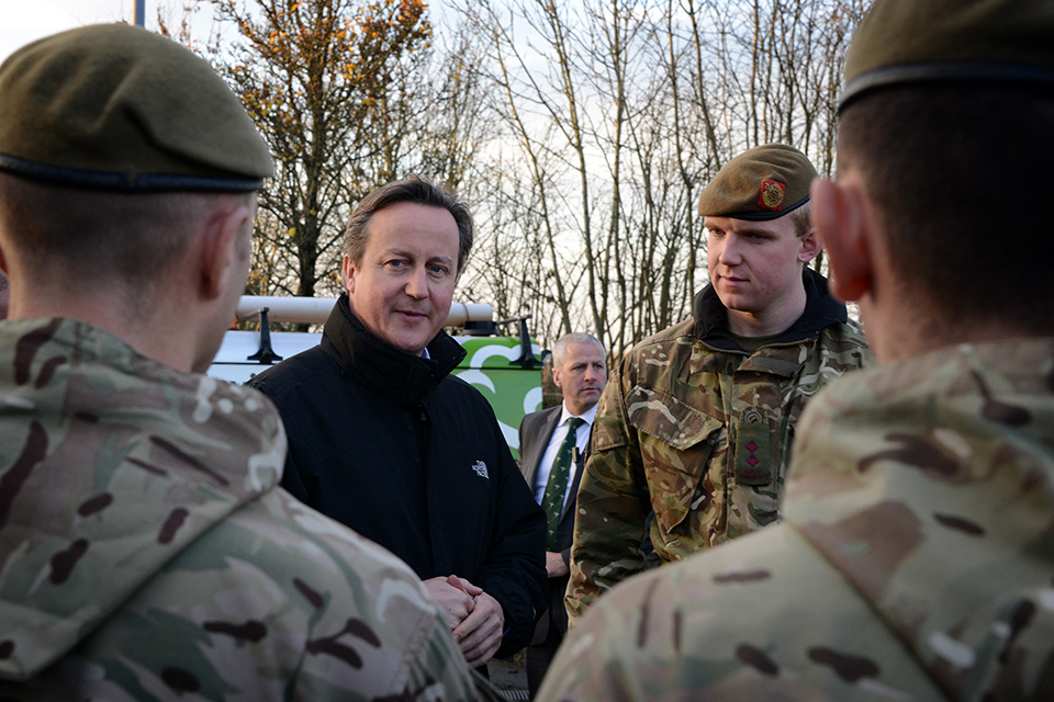 The Prime Minister David Cameron with elements of 5 and 6 Platoon, Blenheim Company, 2nd Battalion The Duke of Lancasters Regiment.