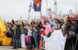 Families on the quayside in Plymouth to welcome home HMS Cumberland