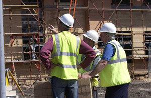 This picture shows builders at a building site