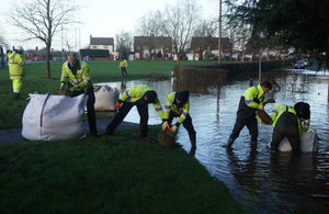 EA staff putting out sandbags