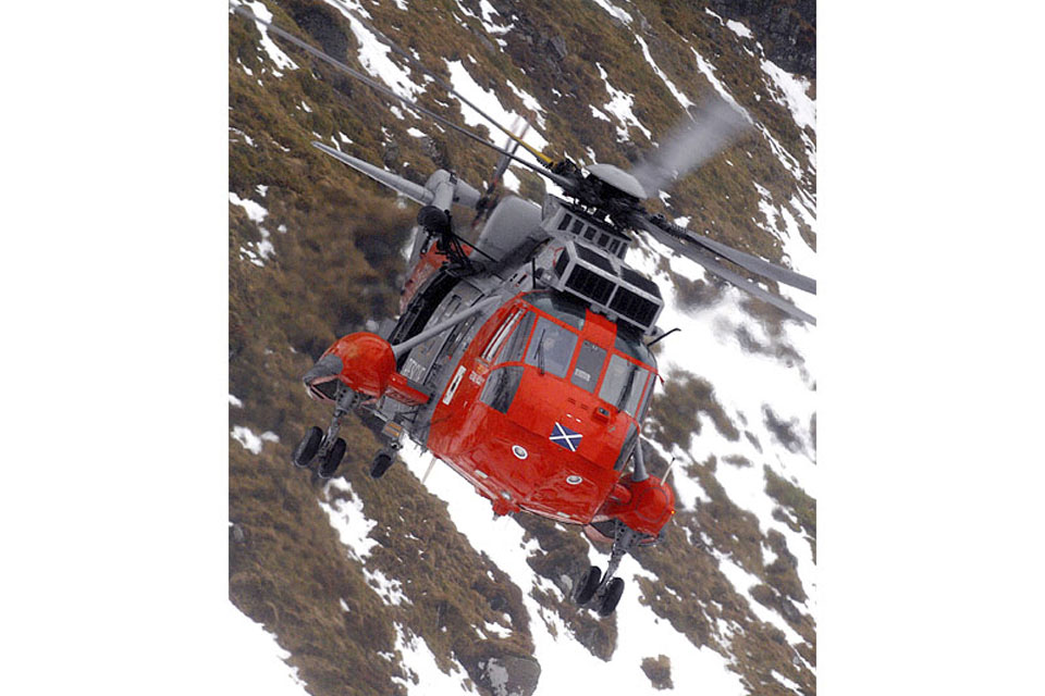 HMS Gannet's Sea King Search and Rescue helicopter in flight above the Scottish Highlands