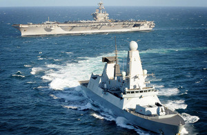 HMS Daring with United States Navy Nimitz Class aircraft carrier the USS Carl Vinson in the background