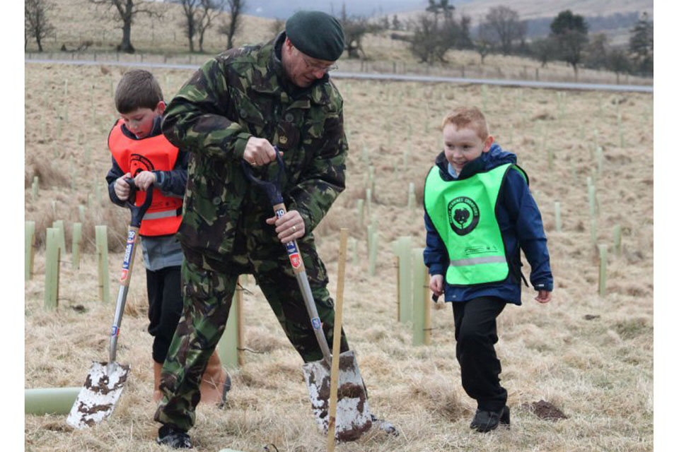 Major Tam Campbell (Ret'd) and volunteers plant trees at Defence Training Estate (DTE) Warcop