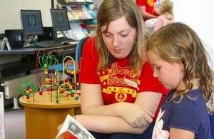 Volunteer with a young reader. Photo credit: Dorset libraries