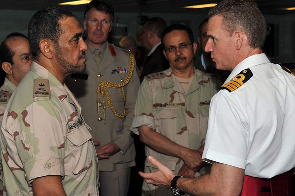 Captain Guy Robinson shows Saudi naval personnel around HMS Daring's Operations Room