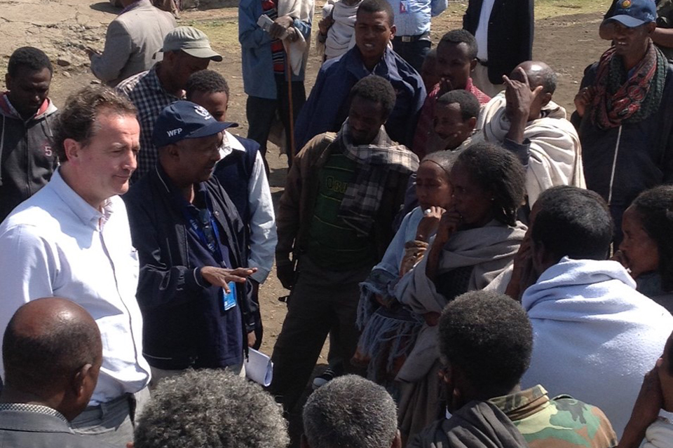 Nick Hurd and WFP staff meet people receiving food aid in northern Ethiopia.