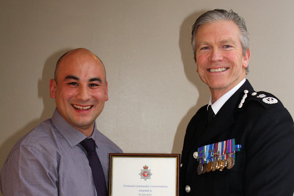 PC John Kelly receives his commendation from the Chief Constable