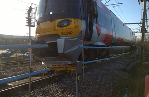 Yellow engineering trolley underneath the train after the collision (image courtesy of Carillion)